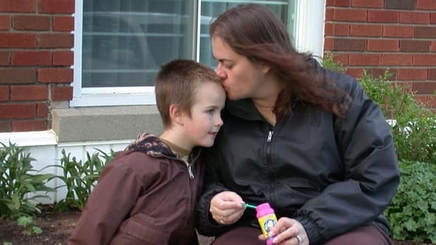 Michael Borowsky, seen here with his mother Julie, has severe autism but was discharged from intensive behavioural therapy at the end of March 2011.