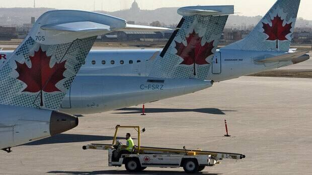 Air Canada planes sit on the tarmac at Pierre Trudeau airport on Friday, March 23, 2012 in Montreal. Ryan Remiorz/Canadian Press