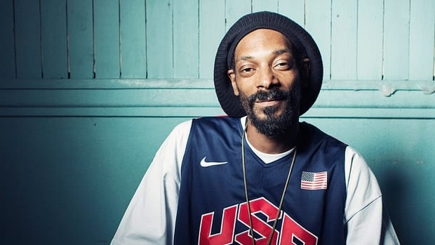 """Rapper Snoop Dogg says he has changed his name to Snoop Lion, after being """"born again"""" during a recent visit to Jamaica, and will release a reggae album called Reincarnated in the fall. It will be accompanied by a documentary film debuting at TIFF and a book."""