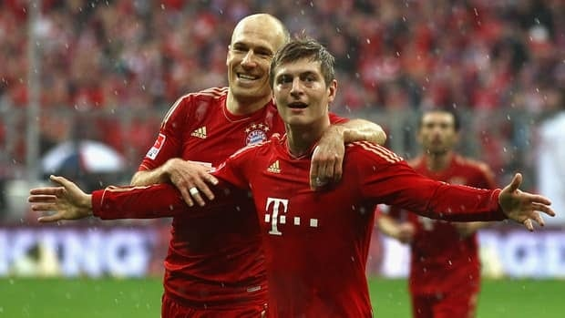 Toni Kroos of Bayern, right, celebrates scoring the opening goal with teammate Arjen Robben.
