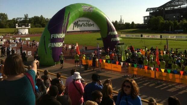 Spectators at the start and finish line of the Manitoba Marathon on Sunday morning.