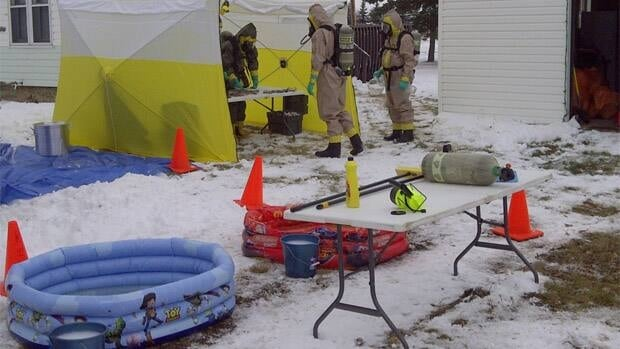 RCMP investigators entered the site wearing safety suits with attached breathing apparatus to protect themselves from the possible toxic effects of the chemicals.