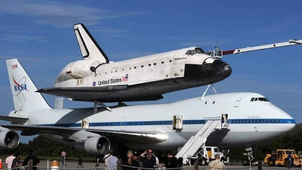 The space shuttle Endeavour is prepared Sunday, Sept. 16, 2012 for transport on a modified Boeing 747 aircraft at the Kennedy Space Center in Cape Canaveral, Fla.