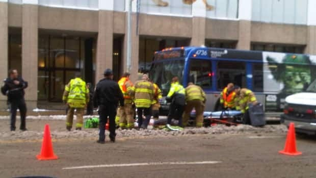 Emergency crews tend to a woman hit by an ETS bus in downtown Edmonton Friday morning.