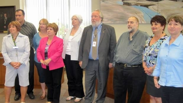 Wayne Fletcher, pictured fourth from the right, has been named the chair of Thunder Bay's disaster relief committee.