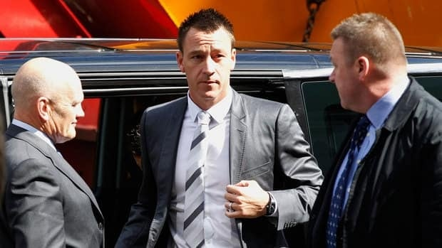 Former England soccer captain and Chelsea player John Terry, center, arrives at Westminster Magistrates Courts in London on Thursday.