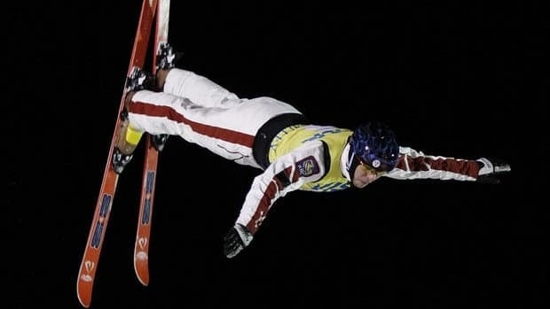Olivier Rochon of Canada flips during a run during the men's aerial final at the World Cup Freestyle skiing competition Friday, Feb. 3, 2012, at Deer Valley Resort in Park City, Utah.