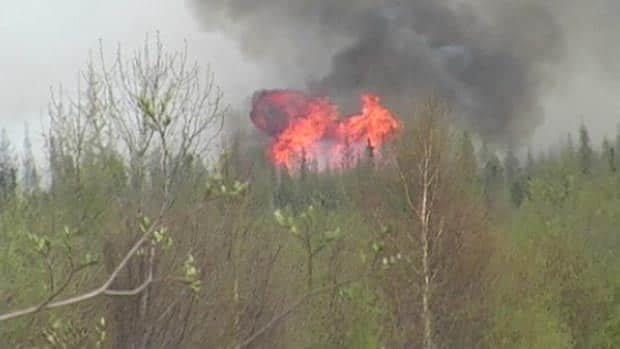 Flames rip through trees in the Grassland area in northeastern Alberta, one of three out-of-control fires in the province.