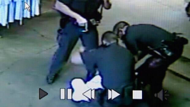 Three officers can be seen holding down Sammy Sobieh in this still from security video taken on Aug. 28, 2011.