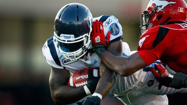Cory Boyd, left, was the CFL's leading rusher this season with 447 yards and was averaging a solid 5.5-yards per carry.