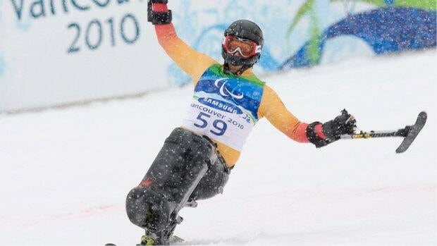 Josh Dueck is seen celebrating his silver medal finish during the Paralympic men's sit-ski slalom event during the 2010 Winter Paralympic Games in Whister.