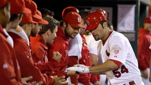 St. Louis Cardinals pitcher Jaime Garcia is congratulated by teammates after hitting a solo home run during the third inning on Monday.
