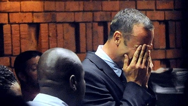 Oscar Pistorius hides his face in his hands in court on Feb. 15 during his preliminary hearing on the charge of murdering his model girlfriend Reeva Steenkamp.