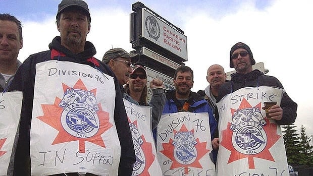 CP Rail strikers walk the picket line in Winnipeg on Monday.