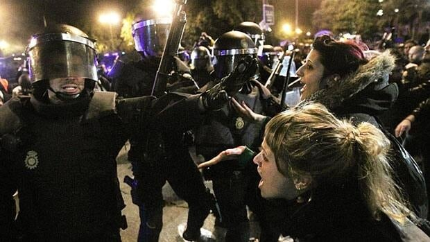 Police clash with protestors during a demonstration in front Parliament against austerity measures announced by the Spanish government in Madrid, Spain, on Sept. 29, 2012.