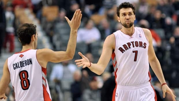 Toronto Raptors teammates Jose Calderon, left, and Andrea Bargnani, right, celebrate a basket while playing against the Denver Nuggets on Wednesday.
