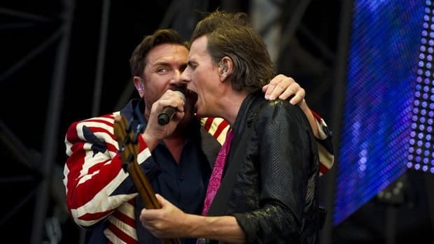 Duran Duran perform at the Olympic Opening Ceremony concert in Hyde Park, London on July 27. They have cancelled two Canadian dates and four in the U.S.