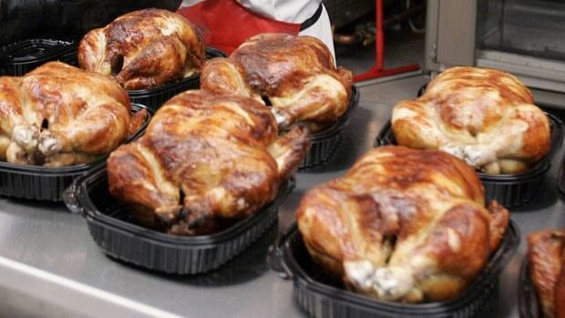A police officer said the man was driving with his knees while eating a rotisserie chicken in a bowl.