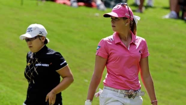 Paula Creamer, right, and Jiyai Shin, of South Korea, watch play on the eighth green during the Kingsmill Championship on Sunday.
