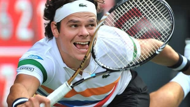 Canada's Milos Raonic of Canada watches his return shot against Kei Nishikori of Japan during their men's final match at the Japan Open tennis tournament. Nishikori won 7-6, 3-6, 6-0.