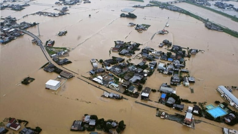 Image result for Torrential rains in Japan force over 1 million to evacuate southwestern region