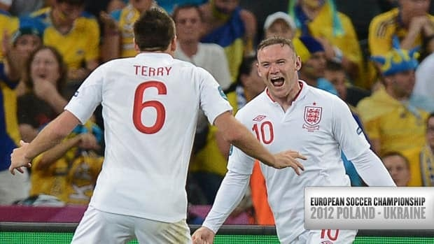 Wayne Rooney, right, and John Terry celebrate after scoring against Ukraine on Tuesday at the Donbass Arena in Donetsk.
