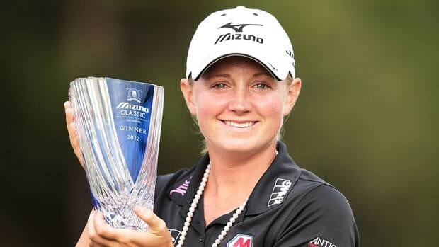 American golfer Stacy Lewis celebrates with the trophy after winning the Mizuno Classic at Kintetsu Kashikojima Country Club on Sunday in Shima, Japan.