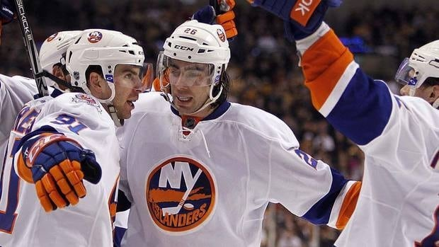 Islanders' John Tavares, left, celebrates his go-ahead goal with teammates Matt Moulson (26) and P.A. Parenteau (15) in the third period.