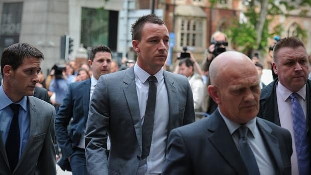 Chelsea and England footballer John Terry, centre, arrives at Westminster Magistrates court in London, on July 13, 2012.