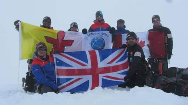 The U.K./Canadian Arctic Jubilee Expedition team celebrates at the summit of Mount Barbeau on Ellesmere Island, the highest point in the Queen Elizabeth Islands, on Thursday.