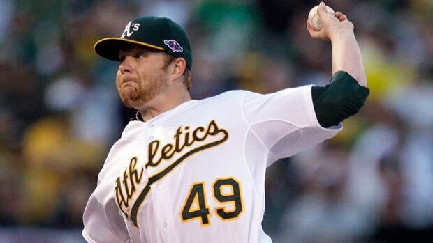 Oakland Athletics starting pitcher Brett Anderson throws during the first inning of Game 3 against Detroit.