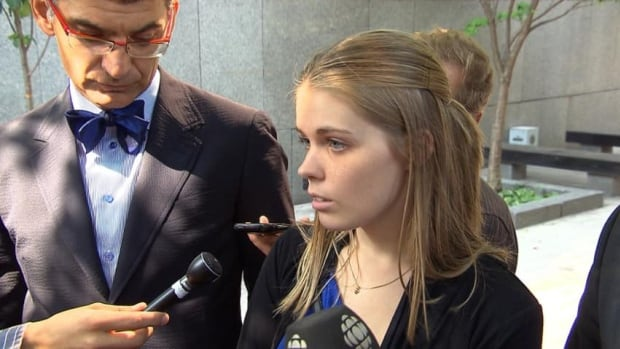 Nursing student Kim Laganière is one of two lead plaintiffs on a class-action lawsuit seeking compensation for the school term she lost to the Quebec student strike. 'I'm not working because I don't have my diploma,' she said Thursday outside the Montreal courthouse, accompanied by her lawyer Michel Savonitto, left.