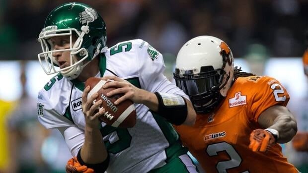 Saskatchewan Roughriders' quarterback Drew Willy, left, is chased down by the B.C. Lions' Lin-J Shell on Saturday November 3, 2012.