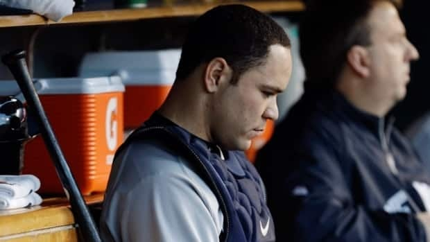 New York Yankees' Russell Martin sits on the bench during during Game 4 of the American League championship series against the Detroit Tigers Thursday, Oct. 18, 2012, in Detroit.