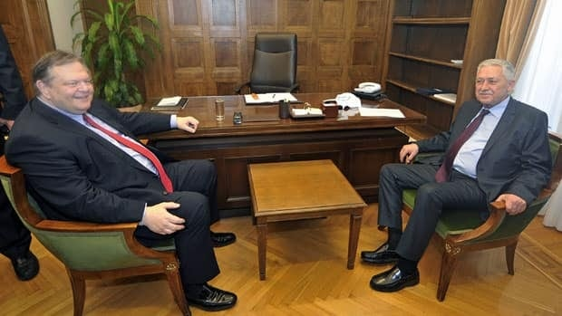 Greek socialist leader Evangelos Venizelos, left, said he made progress towards forming a coalition government after meeting with the leader of the left-wing Dimar party, Fotis Kouvelis, right, in Athens Thursday.