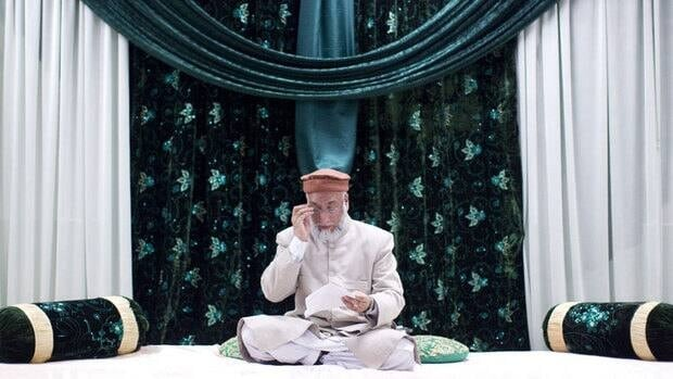 Imam Syed Soharwardy of Calgary reads a copy of a fatwa at the Jamia Riyadhul Jannah place of worship in Mississauga, Ont., on Saturday.