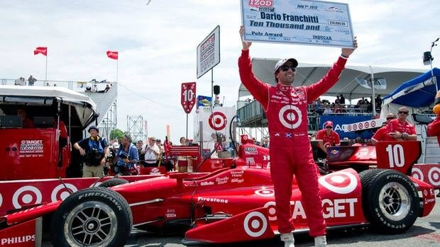 Dario Franchitti celebrates after winning the pole position at the Honday Indy Toronto on Saturday July 7, 2012.