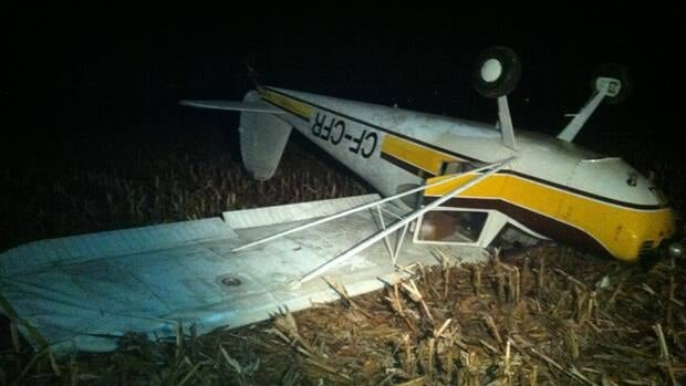 This plane was on its roof after the pilot had a forced landing caused by engine problems.
