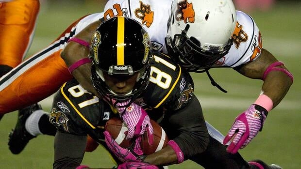 Hamilton Tiger-Cats wide receiver Aaron Kelly is tackled by B.C. Lions defensive back Anthony Reddick on Oct. 22, 2011.
