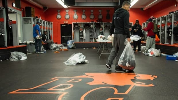 B.C. Lions running back Andrew Harris carries a bag of personal belongings while clearing out his locker at the team's practice facility in Surrey, B.C. on Tuesday.