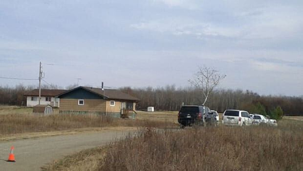 Two adults and one teenager have been charged with first-degree murder in relation to a double-homicide in this home, in the foreground, on the Standing Buffalo First Nation last week.