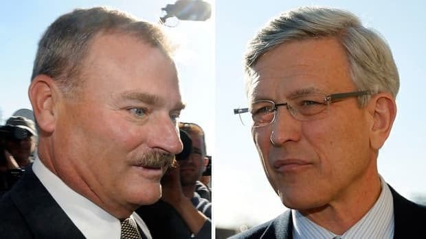 In these Nov. 7, 2011 file photos, former Penn State vice president Gary Schultz, left, and former athletic director Tim Curley, right, enter a district judge's office for an arraignment in Harrisburg, Pa.