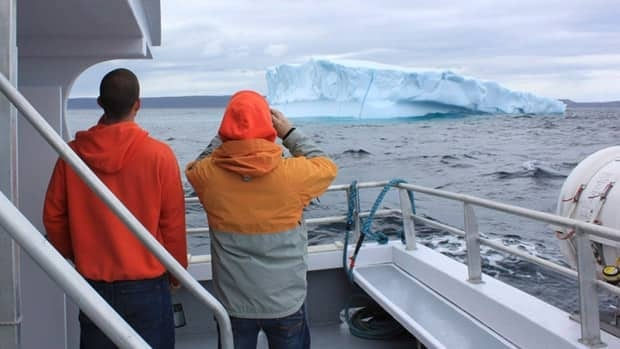 Nathan Stanley and Steve Lake look at an iceberg in the North Atlantic off St. John's aboard Iceberg Quest Ocean Tours.