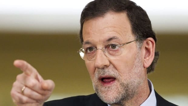 Spain's Prime Minister Mariano Rajoy answers questions after his country became the fourth and largest country to ask Europe to rescue its failing banks, a bailout of up to 100 billion euros.