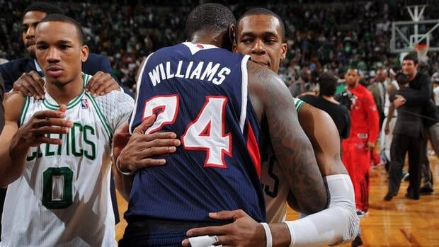 Rajon Rondo of the Boston Celtics hugs Marvin Williams of the Atlanta Hawks after the win in Game Six of the Eastern Conference Quarterfinals during the 2012 NBA Playoffs on May 10, 2012 at TD Garden in Boston, Massachusetts.