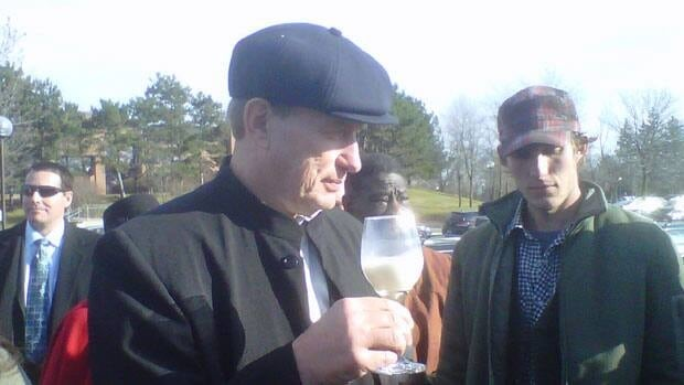 Dairy farmer Michael Schmidt, shown drinking raw milk outside a Newmarket last November, has won the right to appeal his conviction.