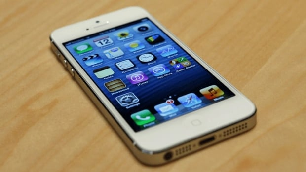 The iPhone 5 is on display after its introduction during Apple Inc.'s iPhone media event in San Francisco Wednesday. It was designed to be thinner than the current 4S model, with a taller screen, but several other new features on the iPhone are already on other smartphones.