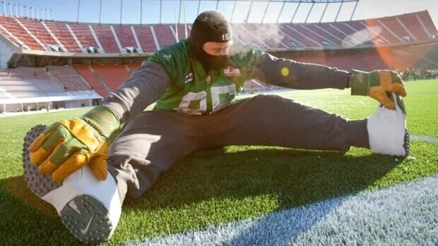 Saskatchewan Roughriders defensive end Shomari Williams stretches during a Grey Cup practice Wednesday, November 24, 2010 in Edmonton.