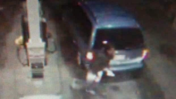 A surveillance camera image taken in 2011 of a Dodge Caravan the suspect was believed to have been driving.