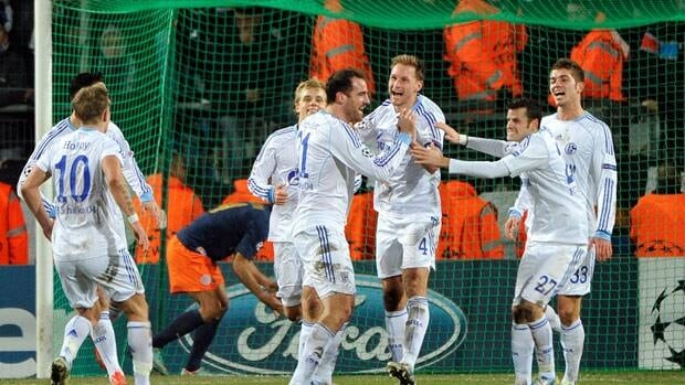Schalke's defender Benedikt Hoewedes, centre, is congratuled by teammates after scoring a goal during the match at the La Mosson stadium in Montpellier, France.